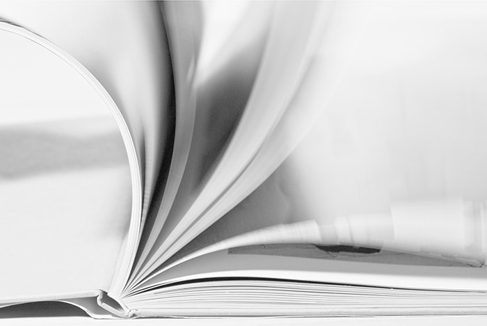 Motion blur photo of the turning pages of a book