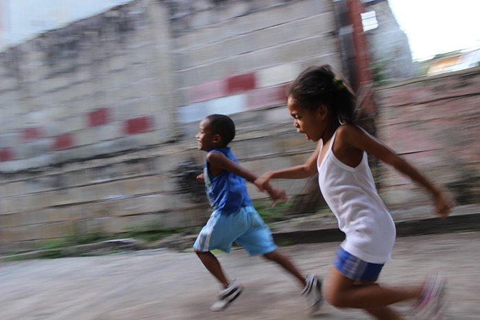 Motion blur photo of children playing
