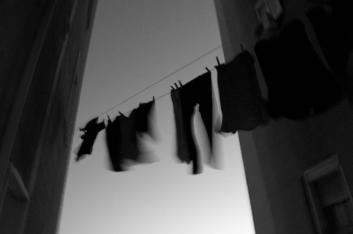 Motion blur photo of hanging clothes moved by the wind