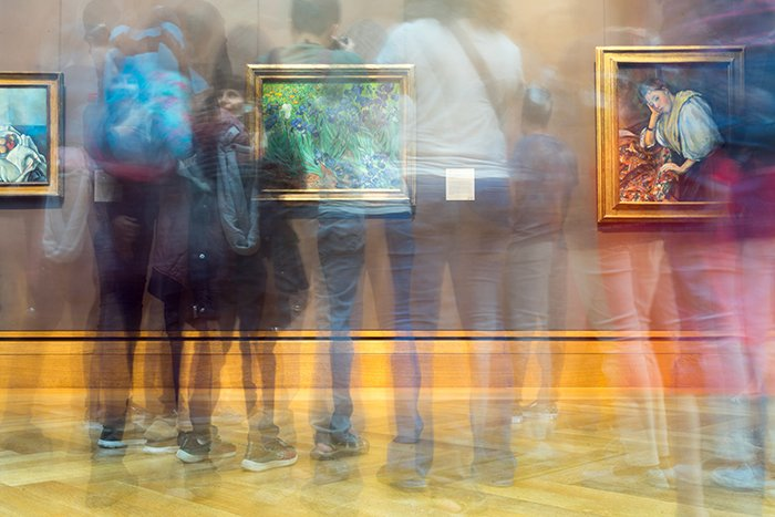 Motion blur photo of a crowd at a museum