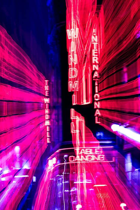 Motion blur photo of neon lights