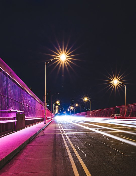 Motion blur photo of a street during nighttime