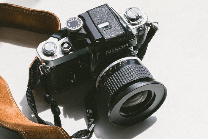 a nikon camera and lens highlighting Nikon lens abbreviations