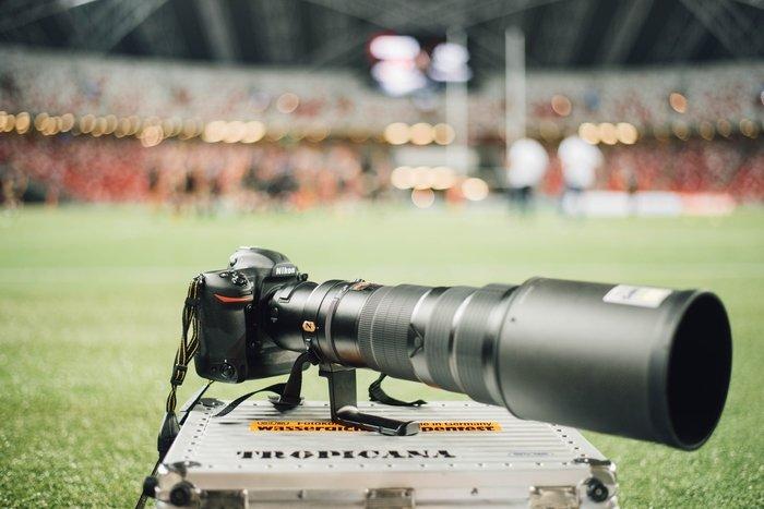 A Nikon Dslr with Nikon telephoto lens