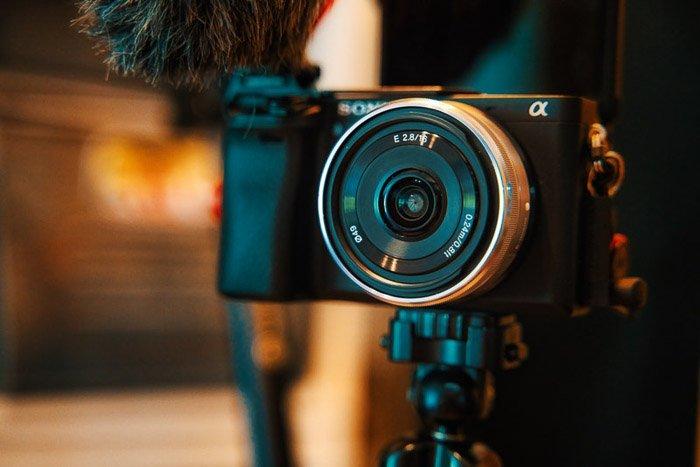A Sony compact camera with a Pancake lens on a tripod