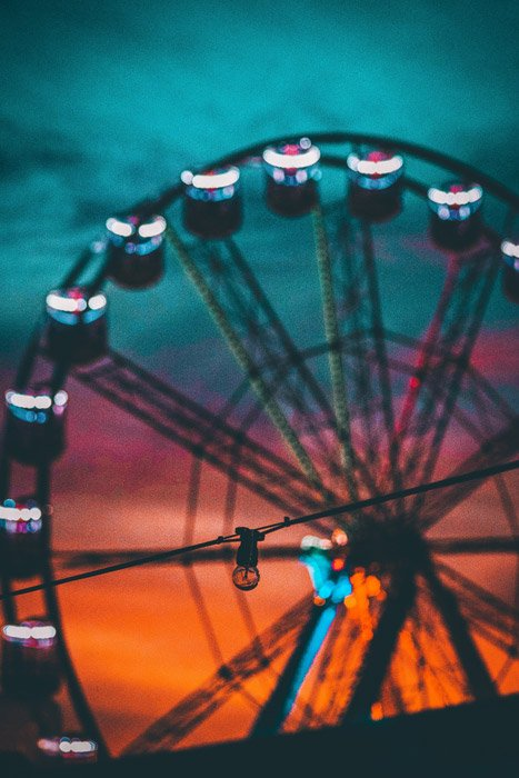 Photo of a ferris wheel at sunset