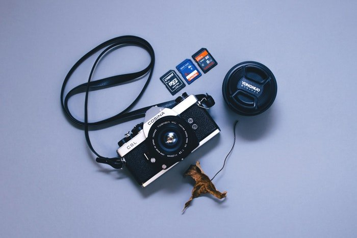 Photo of a camera and three different types of memory cards