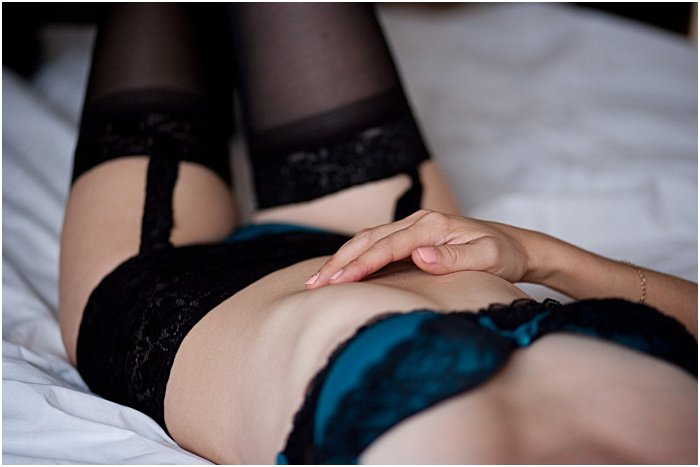 Close-up boudoir photo of the body of a woman