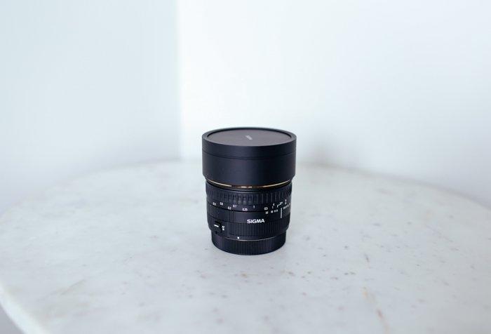 Still life of a sigma lens highlighting Sigma lens abbreviations