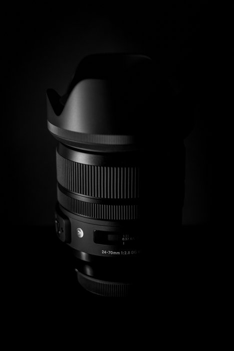 Shadowy still life of a sigma lens highlighting Sigma lens abbreviations