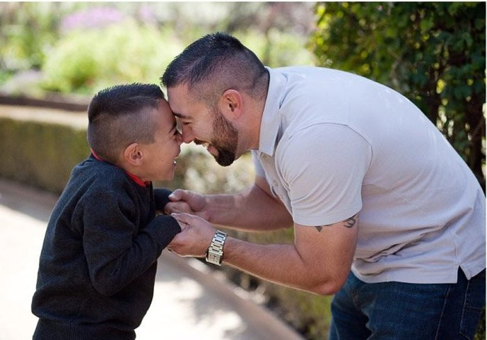 cute portrait of a father and little boy outdoors
