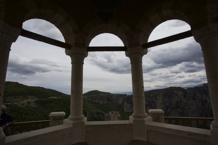 A landscape scene shot through pillars of a building. The sky is correctly exposed, making the pillars too dark.