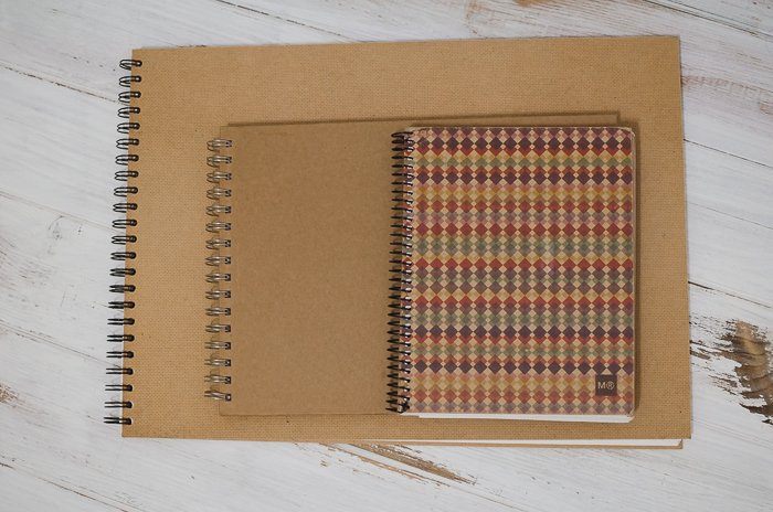 overhead view of various sized notebooks for making a photo journal