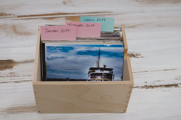 a nbox of printed photo for use in scrapbooking creations