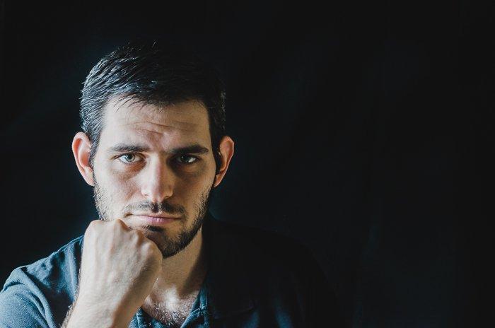 Studio portrait photo of a man using split lighting