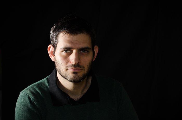 Portrait photo of a man in split lighting