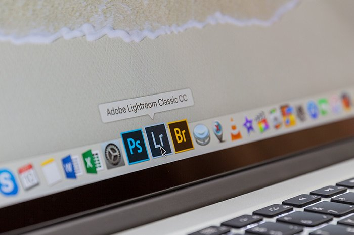 close up of Photoshop, Lightroom, Adobe Camera Raw icons on a laptop screen