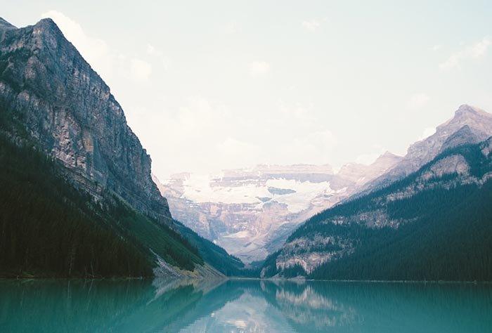 A landscape photo of mountains surrounding a lake