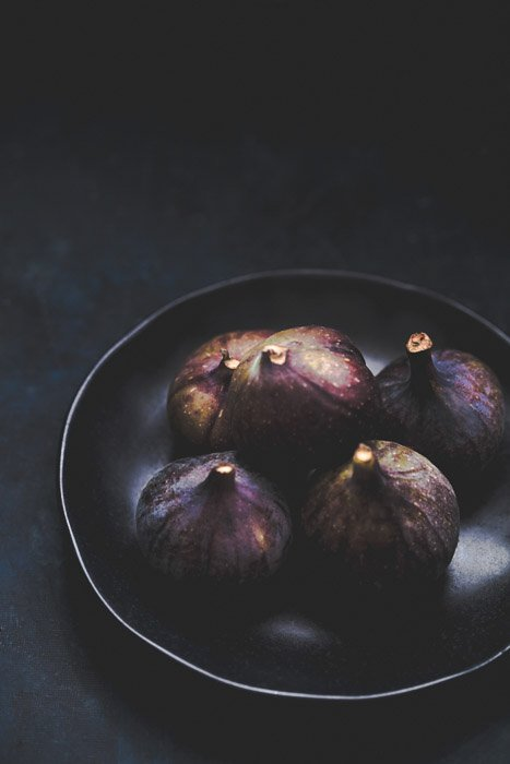 dark and moody food photo of figs in a bowl