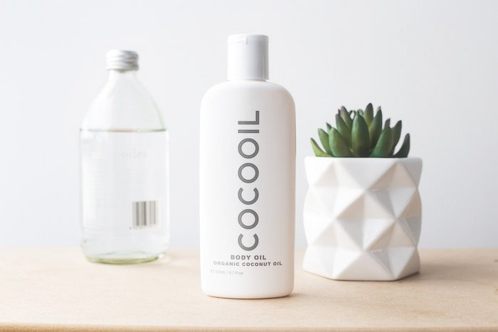 bright and airy product shot of cosmetics and a plant