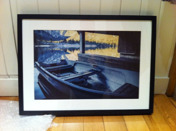 a framed photo of a boat