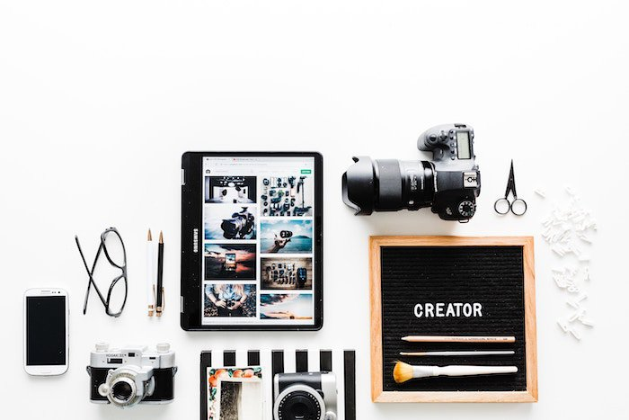a flat lay of various photography business equipment