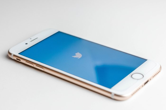 a white iPhone on a white background