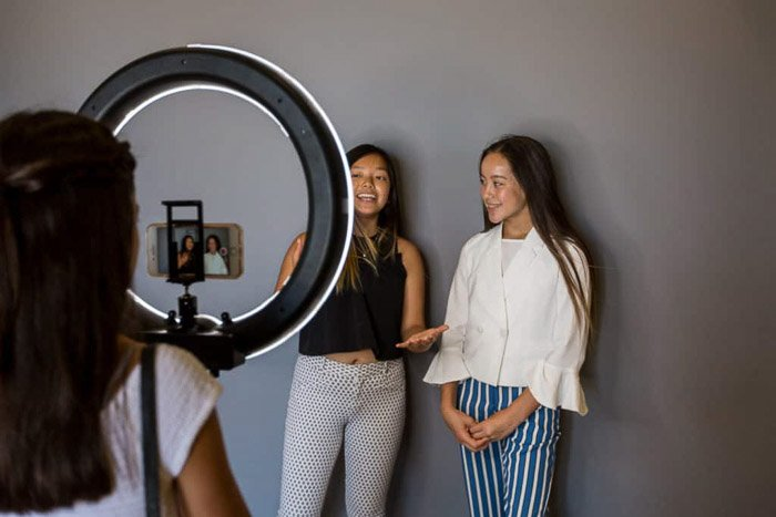 two female models being photographed