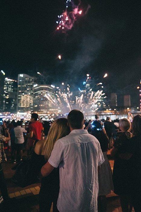 A couple watching a firework show