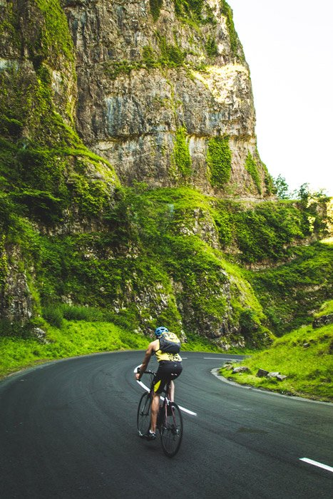 Photo of a man cycling in the mountains