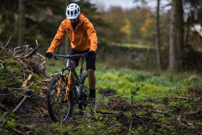Photo of a man mountain biking