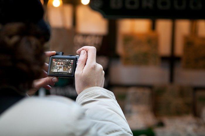 a street image being shot through a digital camera