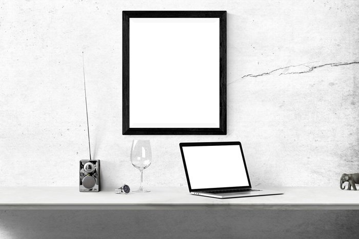 Black and white photo of a mirror and a laptop