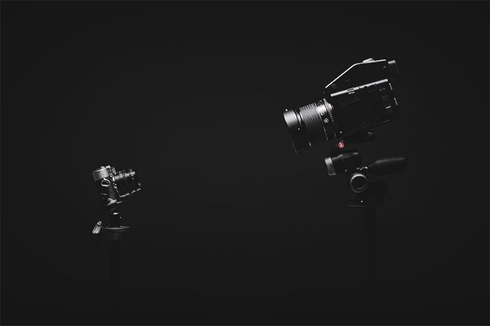 a large camera and small camera facing each other