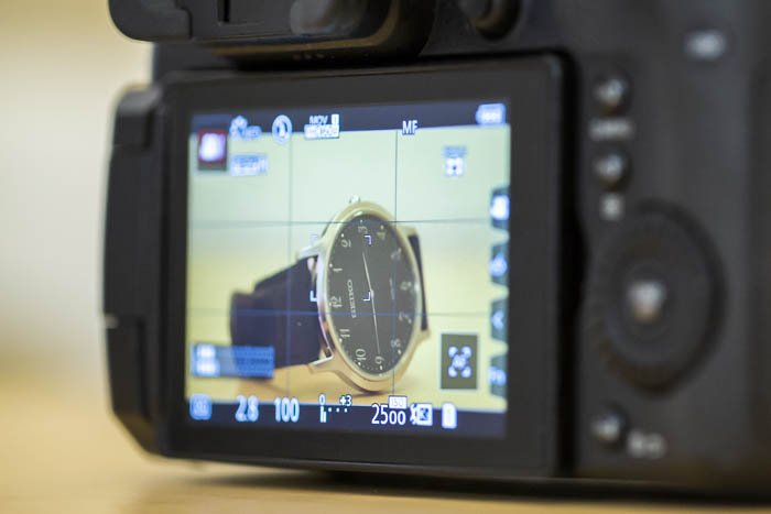 The digital display of a camera showing a watch on the screen