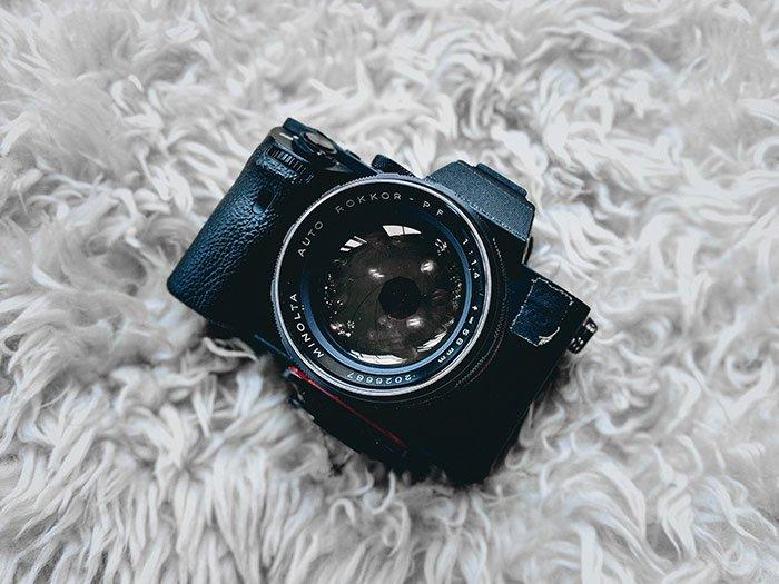 A camera on a white rug