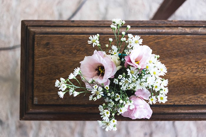 an overhead view of flowers on a closed coffin