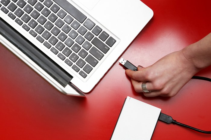 Photo of a laptop and an external drive