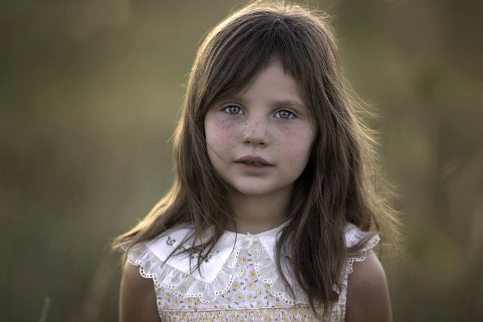 Portrait photo of a girl with freckles