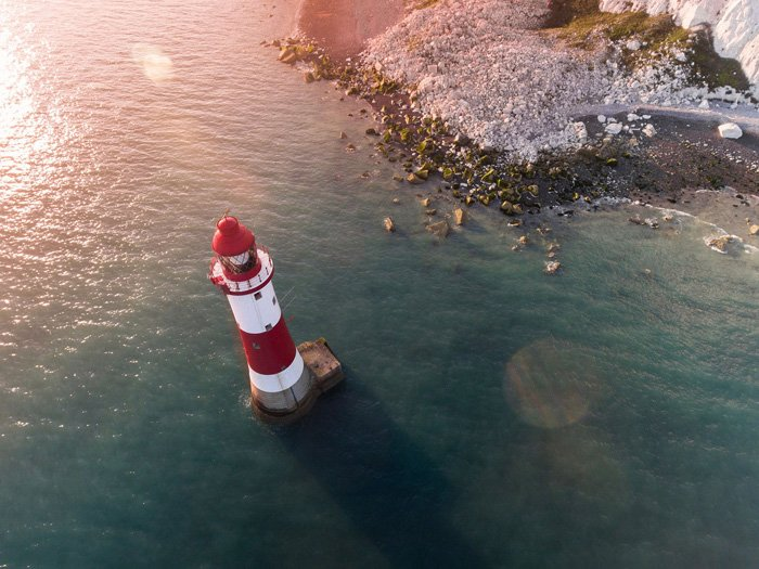 photo of a lighthouse with lens flare
