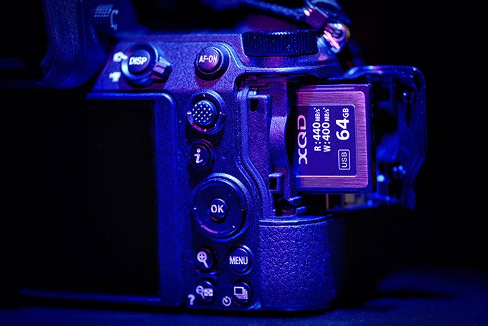 An XQD card being placed into a camera
