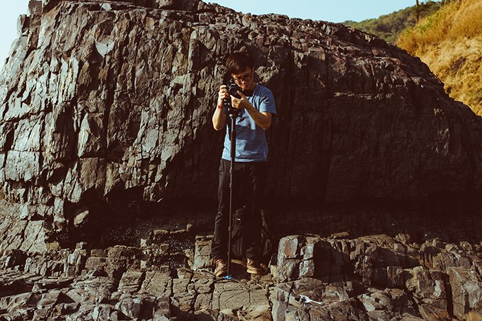 Photo of a man taking a photo with the help of a monopod