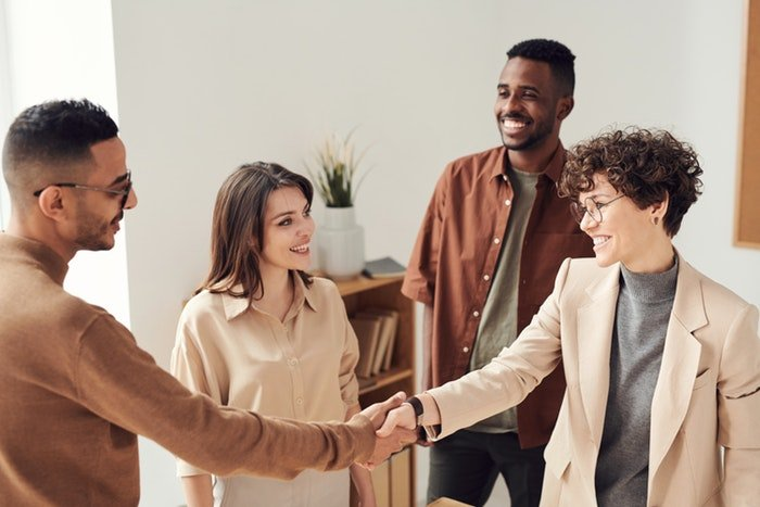 People shaking hands with potential clients