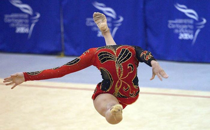 Photo of a gymnast jumping in the air