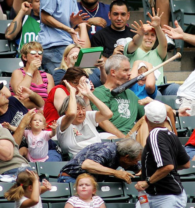 Photo of a baseball bat hitting the face of a man