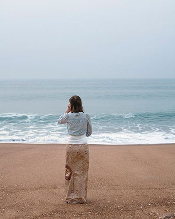 Photo of a woman standing on a beach