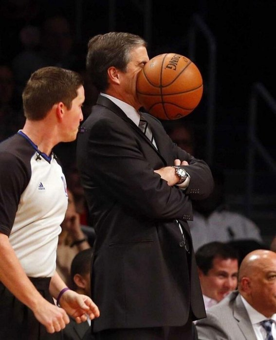 Perfectly timed photo of a basketball hitting a man's face