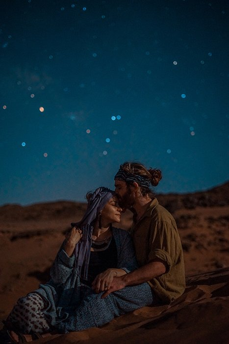 A couple sitting outside under the stars