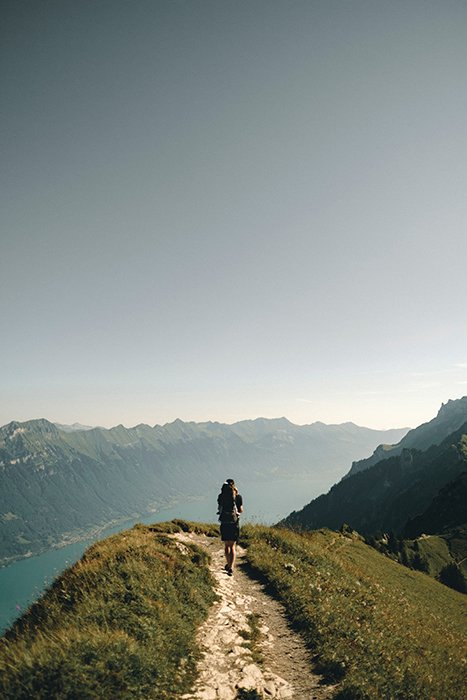 A person standing on the edge of a mountain