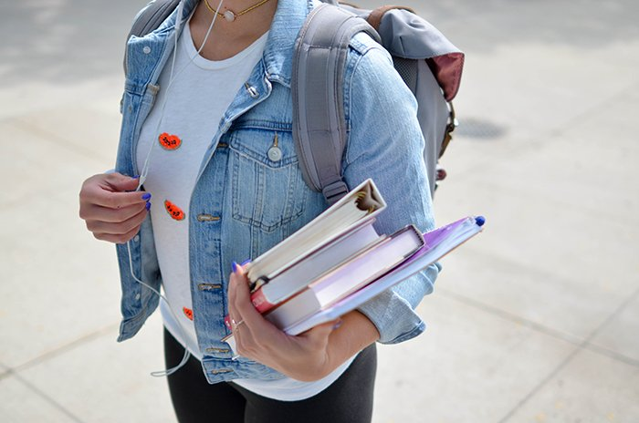 close up of a student holding books